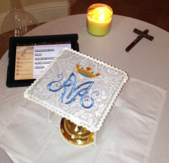 Set up for Mass on the road. Note the iPad is using iBreviary set to begin the Mass for the day. The priest enjoys relatively easy navigation in landscape mode with menu options on the left.