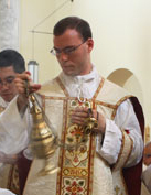 Fr. Walker at his first Mass in 2012. Photo from FSSP web site.